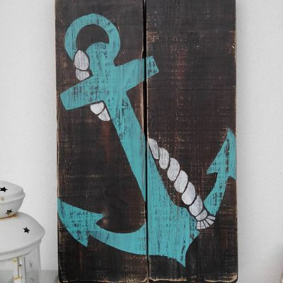 Handmade vintage painting of anchor on recycled wood