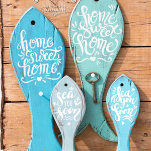 "Handcrafted silhouette fish decor with handmade painting: ""home sweet home"" (keyholder) and ""sea you soon"" (decoration)"